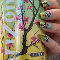 http://craftynail.com/2013/04/21/arizona-green-tea-nails/