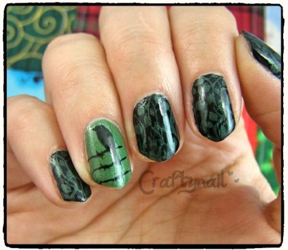 black and green nails with a bird on a wire