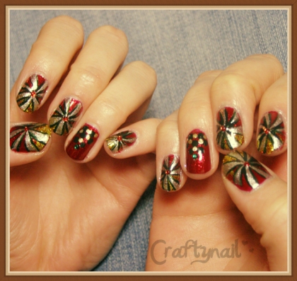 Ored and gold candy swirl nails 2