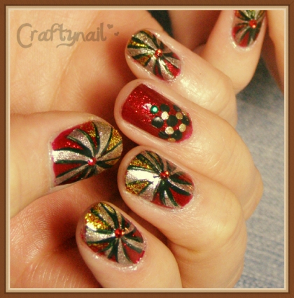 red and gold candy swirl nails